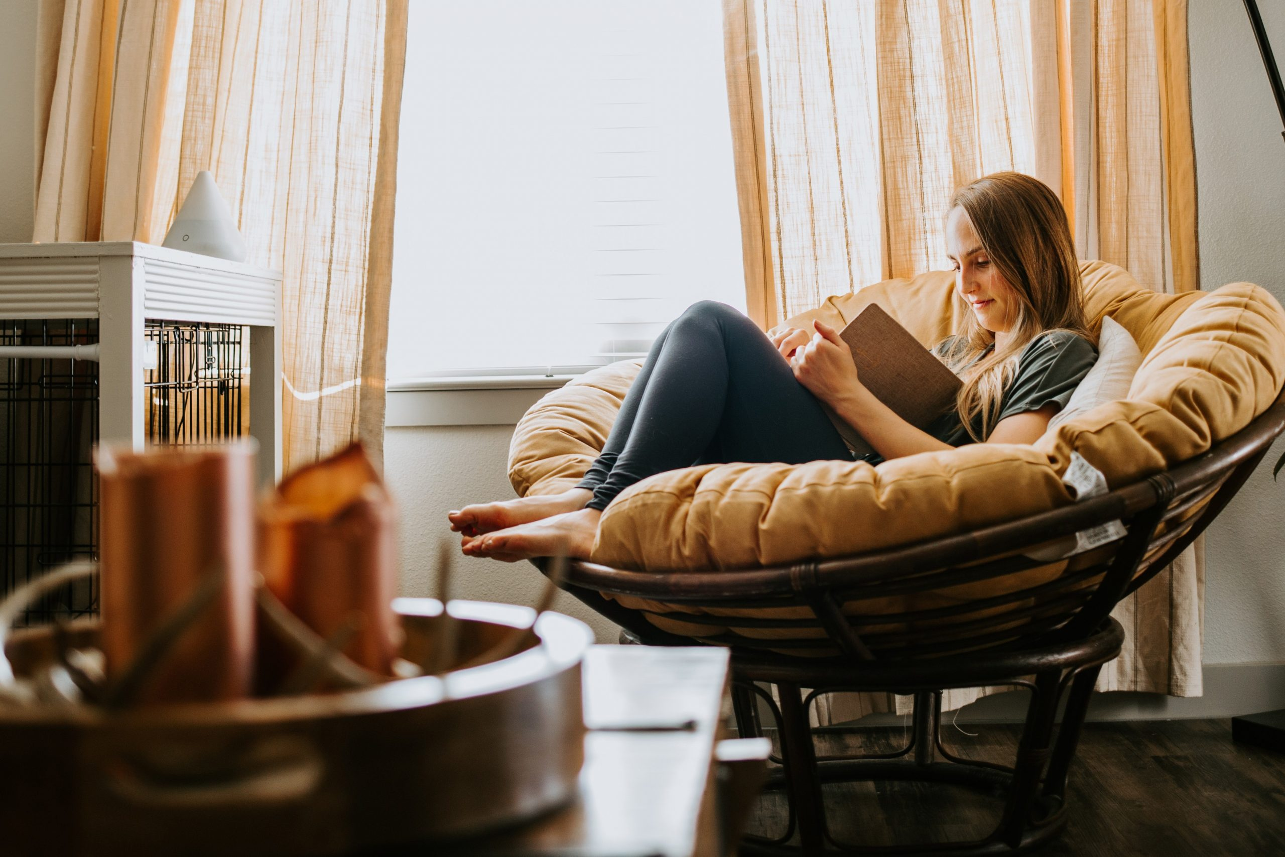 woman reading at home relaxing