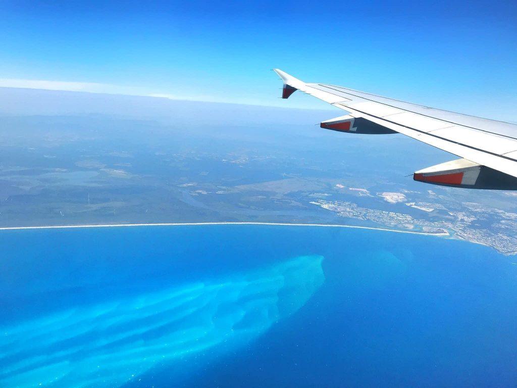 Become a travel nurse Whitsundays plane aerial view ocean