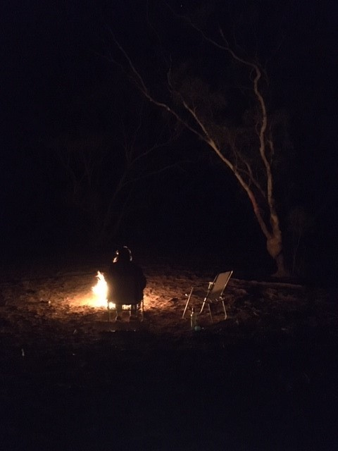 affinity nurses spending time in isolation camp fire at night